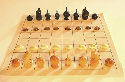 the initial array of Thai chessmen, shown with the traditional cowry shells