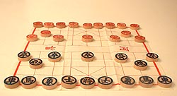 a typical xiangqi (Chinese chess) set, ready to play